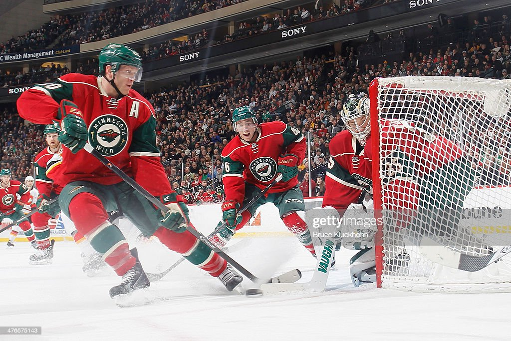 <a gi-track='captionPersonalityLinkClicked' href=/galleries/search?phrase=Ryan+Suter&family=editorial&specificpeople=583306 ng-click='$event.stopPropagation()'>Ryan Suter</a> #20, <a gi-track='captionPersonalityLinkClicked' href=/galleries/search?phrase=Jared+Spurgeon&family=editorial&specificpeople=4594192 ng-click='$event.stopPropagation()'>Jared Spurgeon</a> #46 and goalie <a gi-track='captionPersonalityLinkClicked' href=/galleries/search?phrase=Darcy+Kuemper&family=editorial&specificpeople=6270733 ng-click='$event.stopPropagation()'>Darcy Kuemper</a> #35 of the Minnesota Wild defend the goal during the game against the Calgary Flames on March 3, 2014 at the Xcel Energy Center in St. Paul, Minnesota.