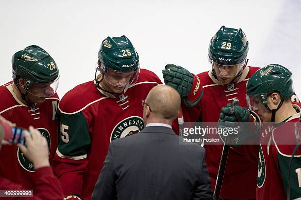 Ryan Suter Jonas Brodin Jason Pominville and Zach Parise of the Minnesota Wild listen to head coach Mike Yeo during the game against the Chicago...