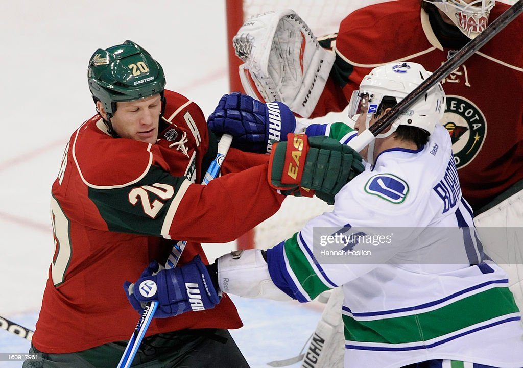 Ryan Suter #20 of the Minnesota Wild and Alex Burrows #14 of the Vancouver Canucks jockey for position in front of the net guarded by Josh Harding #37 of the Minnesota Wild during the third period of the game on February 7, 2013 at Xcel Energy Center in St Paul, Minnesota. The Canucks defeated the Wild 4-1.