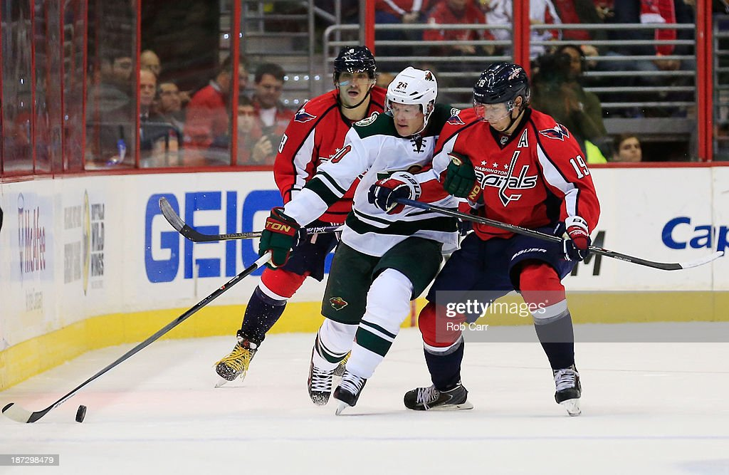 <a gi-track='captionPersonalityLinkClicked' href=/galleries/search?phrase=Ryan+Suter&family=editorial&specificpeople=583306 ng-click='$event.stopPropagation()'>Ryan Suter</a> #20 of the Minnesota Wild and Nicklas Backstrom #19 of the Washington Capitals go after the puck during the third period of the Capitals 3-2 shootout win at Verizon Center on November 7, 2013 in Washington, DC.