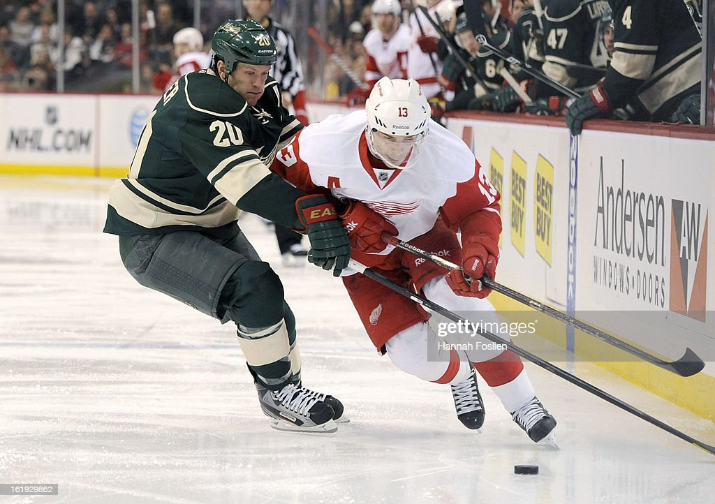 <a gi-track='captionPersonalityLinkClicked' href=/galleries/search?phrase=Ryan+Suter&family=editorial&specificpeople=583306 ng-click='$event.stopPropagation()'>Ryan Suter</a> #20 of the Minnesota Wild attempts to get the puck away from <a gi-track='captionPersonalityLinkClicked' href=/galleries/search?phrase=Pavel+Datsyuk&family=editorial&specificpeople=202893 ng-click='$event.stopPropagation()'>Pavel Datsyuk</a> #13 of the Detroit Red Wings during the third period of the game on February 17, 2013 at Xcel Energy Center in St Paul, Minnesota. The Wild defeated the Red Wings 3-2.