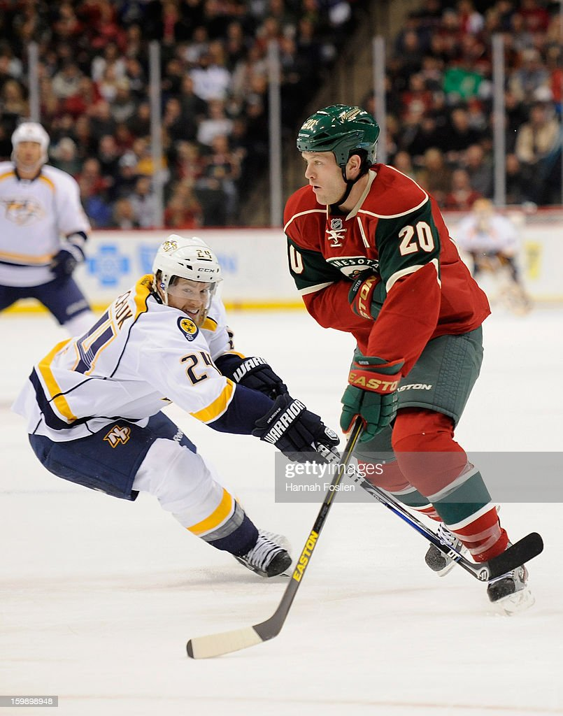 Ryan Suter #20 of the Minnesota Wild controls the puck against Matt Halischuk #24 of the Nashville Predators during the first period of the game on January 22, 2013 at Xcel Energy Center in St Paul, Minnesota.