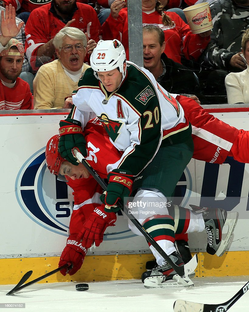 <a gi-track='captionPersonalityLinkClicked' href=/galleries/search?phrase=Ryan+Suter&family=editorial&specificpeople=583306 ng-click='$event.stopPropagation()'>Ryan Suter</a> #20 of the Minnesota Wild hits <a gi-track='captionPersonalityLinkClicked' href=/galleries/search?phrase=Valtteri+Filppula&family=editorial&specificpeople=2234404 ng-click='$event.stopPropagation()'>Valtteri Filppula</a> #51 of the Detroit Red Wings during a NHL game at Joe Louis Arena on January 25, 2013 in Detroit, Michigan. Detroit won the game 5-3.