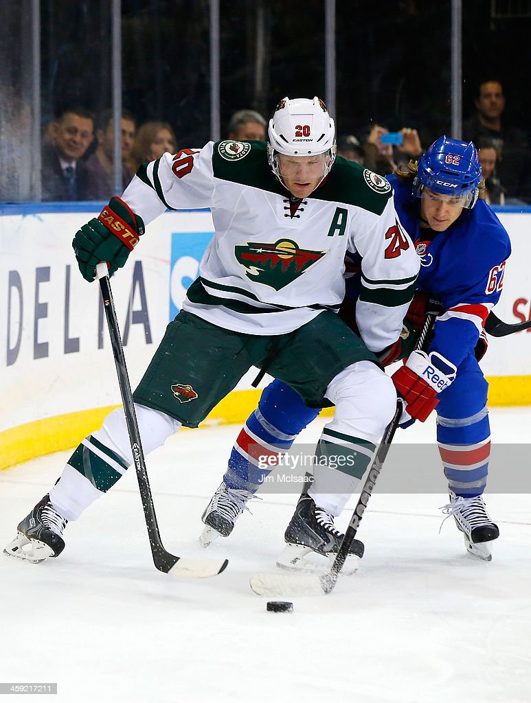 <a gi-track='captionPersonalityLinkClicked' href=/galleries/search?phrase=Ryan+Suter&family=editorial&specificpeople=583306 ng-click='$event.stopPropagation()'>Ryan Suter</a> #20 of the Minnesota Wild in action against the New York Rangers at Madison Square Garden on December 22, 2013 in New York City. The Rangers defeated the Wild 4-1.