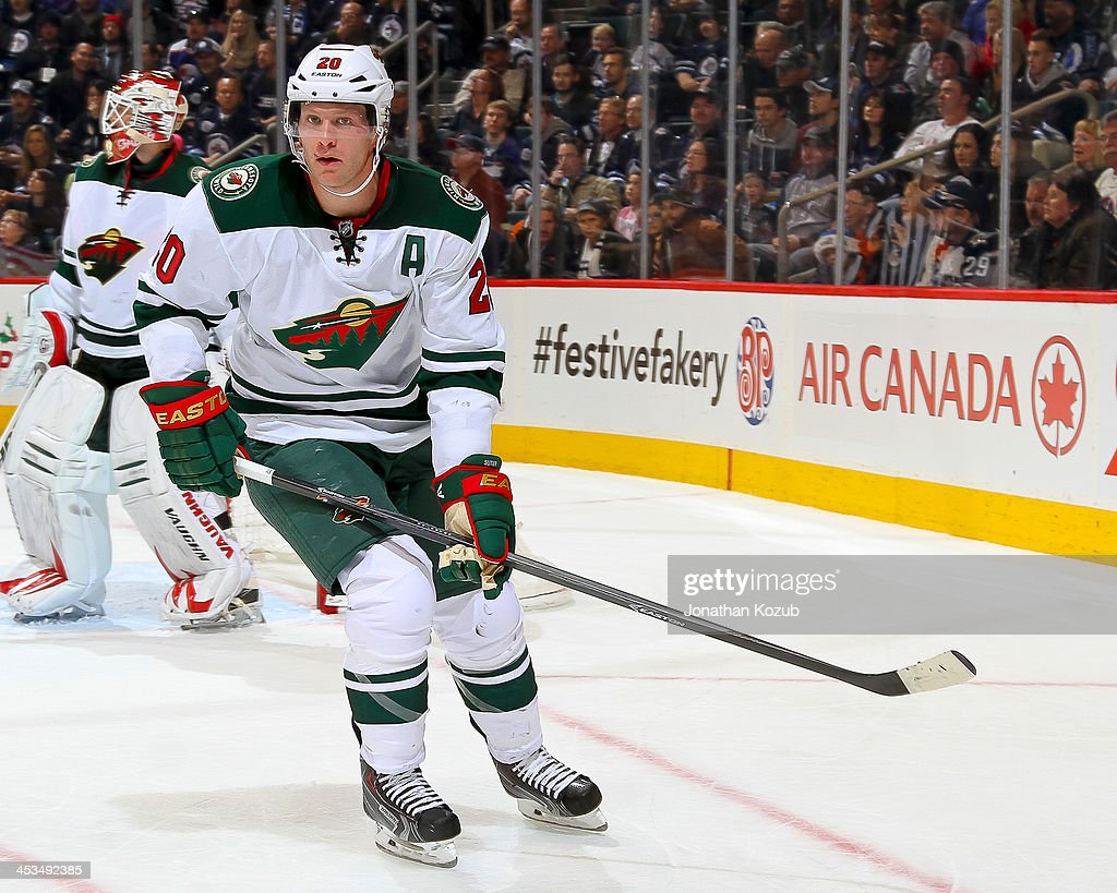 <a gi-track='captionPersonalityLinkClicked' href=/galleries/search?phrase=Ryan+Suter&family=editorial&specificpeople=583306 ng-click='$event.stopPropagation()'>Ryan Suter</a> #20 of the Minnesota Wild keeps an eye on the play during third period action against the Winnipeg Jets at the MTS Centre on November 23, 2013 in Winnipeg, Manitoba, Canada. The Wild defeated the Jets 3-2 in the shootout.