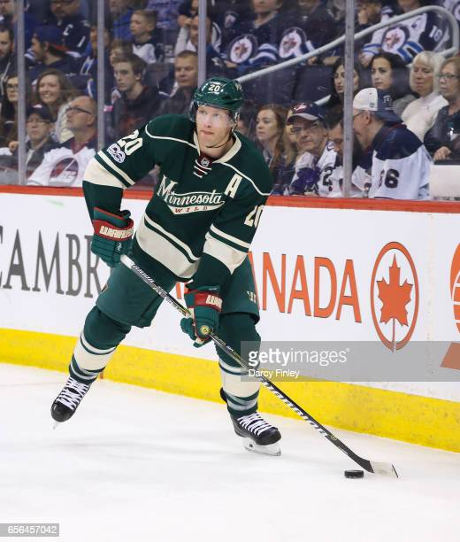 Ryan Suter of the Minnesota Wild plays the puck during first period action against the Winnipeg Jets at the MTS Centre on March 19 2017 in Winnipeg...