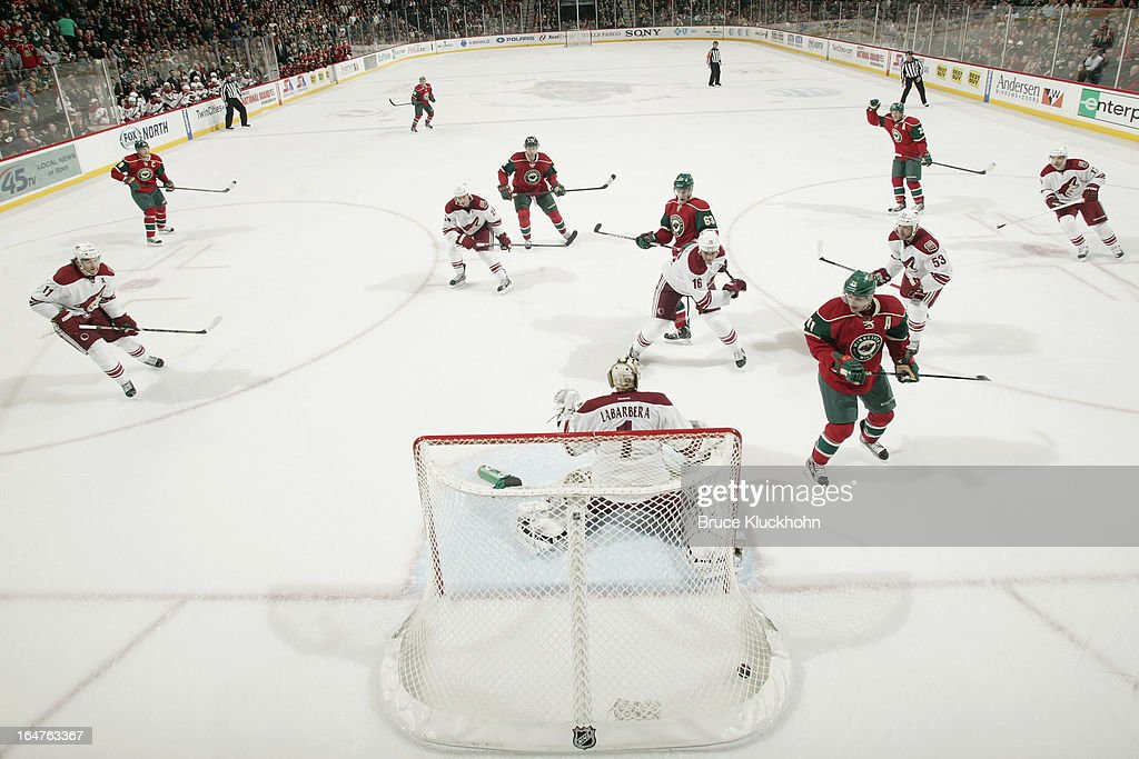 <a gi-track='captionPersonalityLinkClicked' href=/galleries/search?phrase=Ryan+Suter&family=editorial&specificpeople=583306 ng-click='$event.stopPropagation()'>Ryan Suter</a> #20 of the Minnesota Wild raises his hand in celebration after scoring a goal to tie the game with less than a minute remaining in the third period against the Phoenix Coyotes on March 27, 2013 at the Xcel Energy Center in Saint Paul, Minnesota.