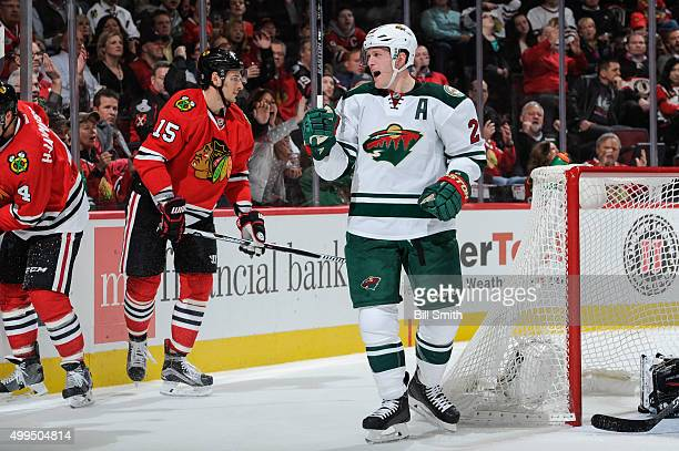 Ryan Suter of the Minnesota Wild reacts after scoring against the Chicago Blackhawks in the third period of the NHL game at the United Center on...