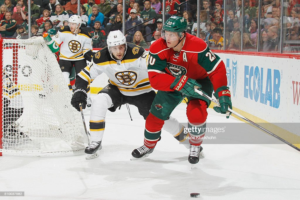 <a gi-track='captionPersonalityLinkClicked' href=/galleries/search?phrase=Ryan+Suter&family=editorial&specificpeople=583306 ng-click='$event.stopPropagation()'>Ryan Suter</a> #20 of the Minnesota Wild skates with the puck while <a gi-track='captionPersonalityLinkClicked' href=/galleries/search?phrase=Ryan+Spooner&family=editorial&specificpeople=5617370 ng-click='$event.stopPropagation()'>Ryan Spooner</a> #51 of the Boston Bruins defends during the game on February 13, 2016 at the Xcel Energy Center in St. Paul, Minnesota.