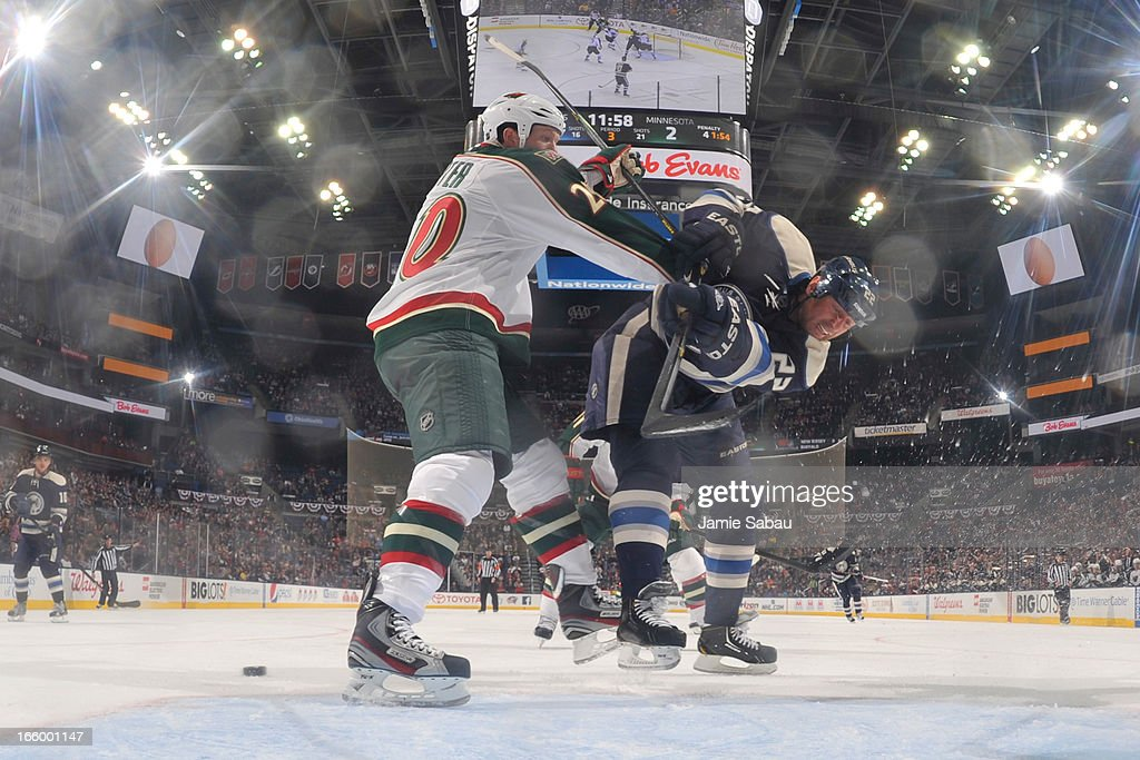 <a gi-track='captionPersonalityLinkClicked' href=/galleries/search?phrase=Ryan+Suter&family=editorial&specificpeople=583306 ng-click='$event.stopPropagation()'>Ryan Suter</a> #20 of the Minnesota Wild ties up Vinny Prospal #22 of the Columbus Blue Jackets preventing him from taking a pass during the third period on April 7, 2013 at Nationwide Arena in Columbus, Ohio. Minnesota defeated Columbus 3-0.