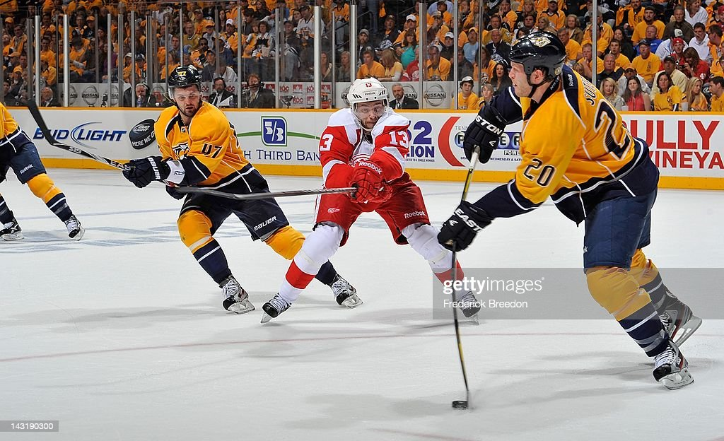 <a gi-track='captionPersonalityLinkClicked' href=/galleries/search?phrase=Ryan+Suter&family=editorial&specificpeople=583306 ng-click='$event.stopPropagation()'>Ryan Suter</a> #20 of the Nashville Predators passes a puck past <a gi-track='captionPersonalityLinkClicked' href=/galleries/search?phrase=Pavel+Datsyuk&family=editorial&specificpeople=202893 ng-click='$event.stopPropagation()'>Pavel Datsyuk</a> #13 of the Detroit Red Wings and <a gi-track='captionPersonalityLinkClicked' href=/galleries/search?phrase=Alexander+Radulov&family=editorial&specificpeople=3955336 ng-click='$event.stopPropagation()'>Alexander Radulov</a> #47 of the Nashville Predators in Game Five of the Western Conference Quarterfinals during the 2012 NHL Stanley Cup Playoffs at the Bridgestone Arena on April 20, 2012 in Nashville, Tennessee.