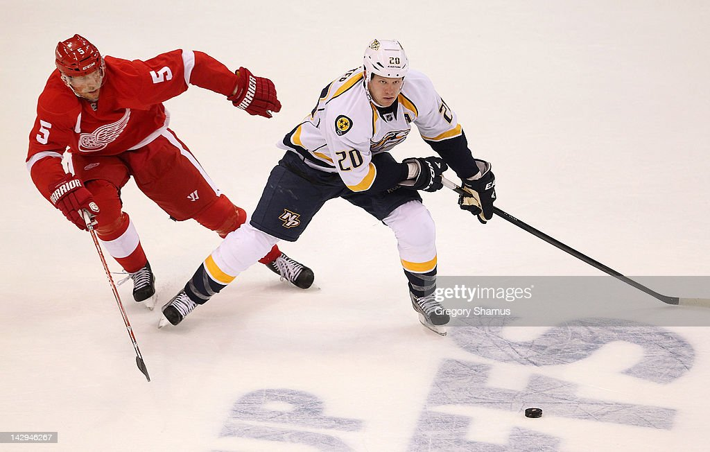 <a gi-track='captionPersonalityLinkClicked' href=/galleries/search?phrase=Ryan+Suter&family=editorial&specificpeople=583306 ng-click='$event.stopPropagation()'>Ryan Suter</a> #20 of the Nashville Predators tries to get around the stick of <a gi-track='captionPersonalityLinkClicked' href=/galleries/search?phrase=Nicklas+Lidstrom&family=editorial&specificpeople=201470 ng-click='$event.stopPropagation()'>Nicklas Lidstrom</a> #5 of the Detroit Red Wings during Game Three of the Western Conference Quarterfinals during the 2012 NHL Stanley Cup Playoffs at Joe Louis Arena on April 15, 2012 in Detroit, Michigan. Nashville won the game 3-2 and lead the series 2-1.