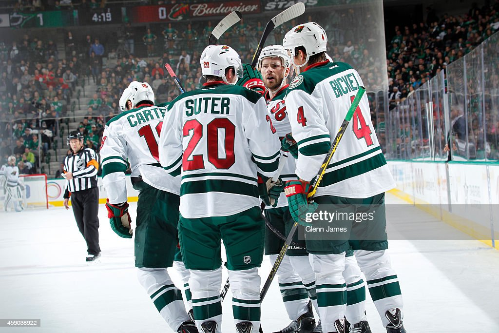 <a gi-track='captionPersonalityLinkClicked' href=/galleries/search?phrase=Ryan+Suter&family=editorial&specificpeople=583306 ng-click='$event.stopPropagation()'>Ryan Suter</a> #20, <a gi-track='captionPersonalityLinkClicked' href=/galleries/search?phrase=Stu+Bickel&family=editorial&specificpeople=4862669 ng-click='$event.stopPropagation()'>Stu Bickel</a> #4, <a gi-track='captionPersonalityLinkClicked' href=/galleries/search?phrase=Erik+Haula&family=editorial&specificpeople=5894652 ng-click='$event.stopPropagation()'>Erik Haula</a> #56 and <a gi-track='captionPersonalityLinkClicked' href=/galleries/search?phrase=Ryan+Carter+-+Ice+Hockey+Player&family=editorial&specificpeople=3144941 ng-click='$event.stopPropagation()'>Ryan Carter</a> #18 of the Minnesota Wild celebrate a goal against the Dallas Stars at the American Airlines Center on November 15, 2014 in Dallas, Texas.