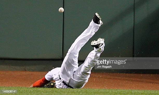 Ryan Sweeney of the Boston Red Sox is unable to catch a ball hit by Prince Fielder of the Detroit Tigers in the ninth inning at Fenway Park May 31...