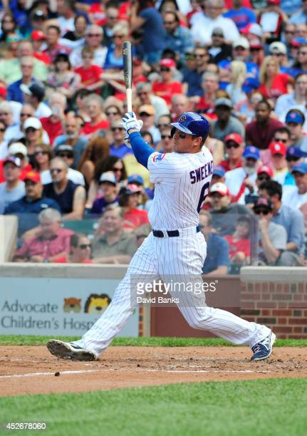 Ryan Sweeney of the Chicago Cubs hits a threerun homer against the St Louis Cardinals during the second inning on July 25 2014 at Wrigley Field in...