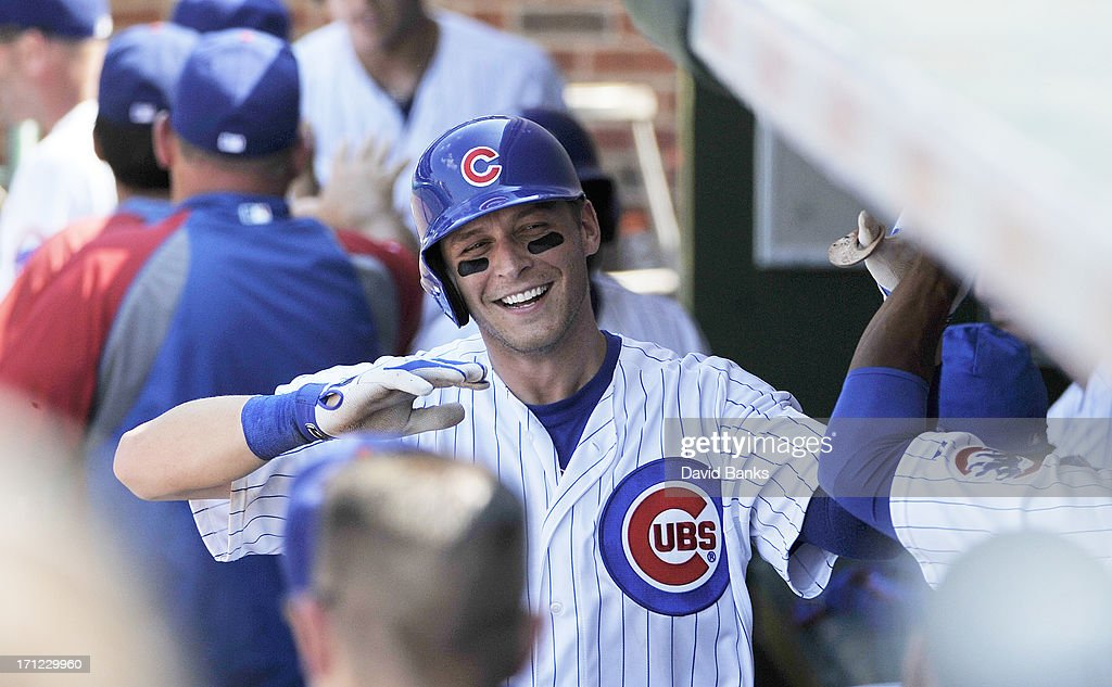 Ryan Sweeney #6 of the Chicago Cubs is greeted after hitting a three-run homer against the Houston Astros during the seventh inning on June 23, 2013 at Wrigley Field in Chicago, Illinois.