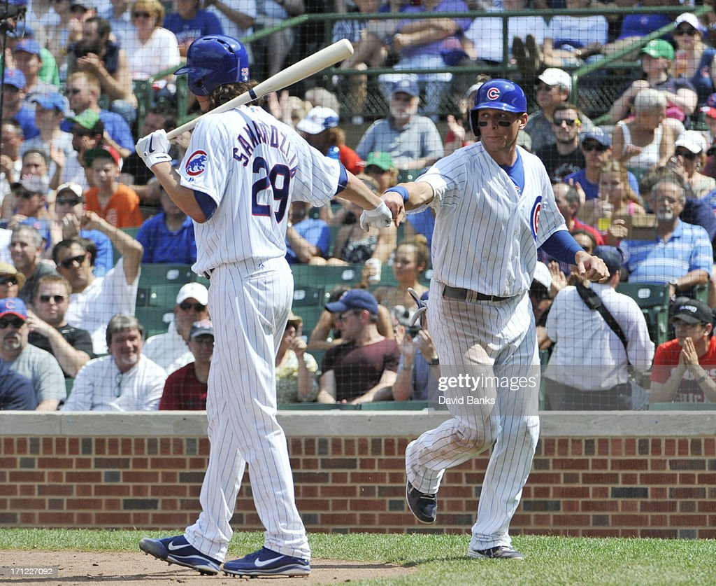Ryan Sweeney #6 of the Chicago Cubs is greeted after scoring by Jeff Samardzija #29 during the fifth inning against the Houston Astros on June 23, 2013 at Wrigley Field in Chicago, Illinois.