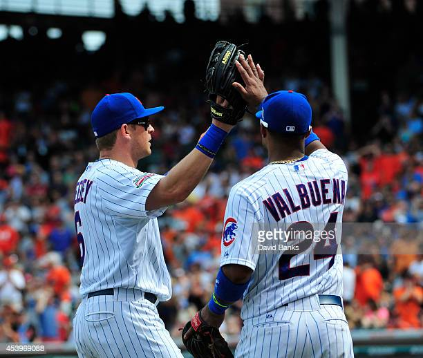 Ryan Sweeney of the Chicago Cubs is greeted by Luis Valbuena after making a play against the Baltimore Orioles during the fifth inning on August 22...