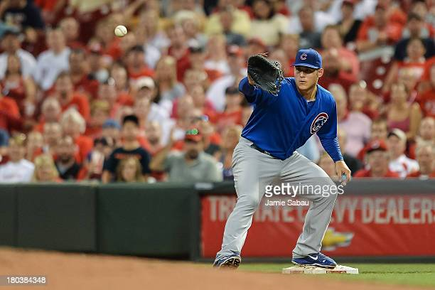 Ryan Sweeney of the Chicago Cubs plays first base against the Cincinnati Reds at Great American Ball Park on September 9 2013 in Cincinnati Ohio