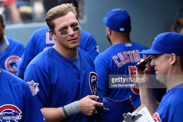 Ryan Sweeney of the Chicago Cubs returns to the dugout after scoring in the eighth inning against the Los Angeles Dodgers at Dodger Stadium on August...