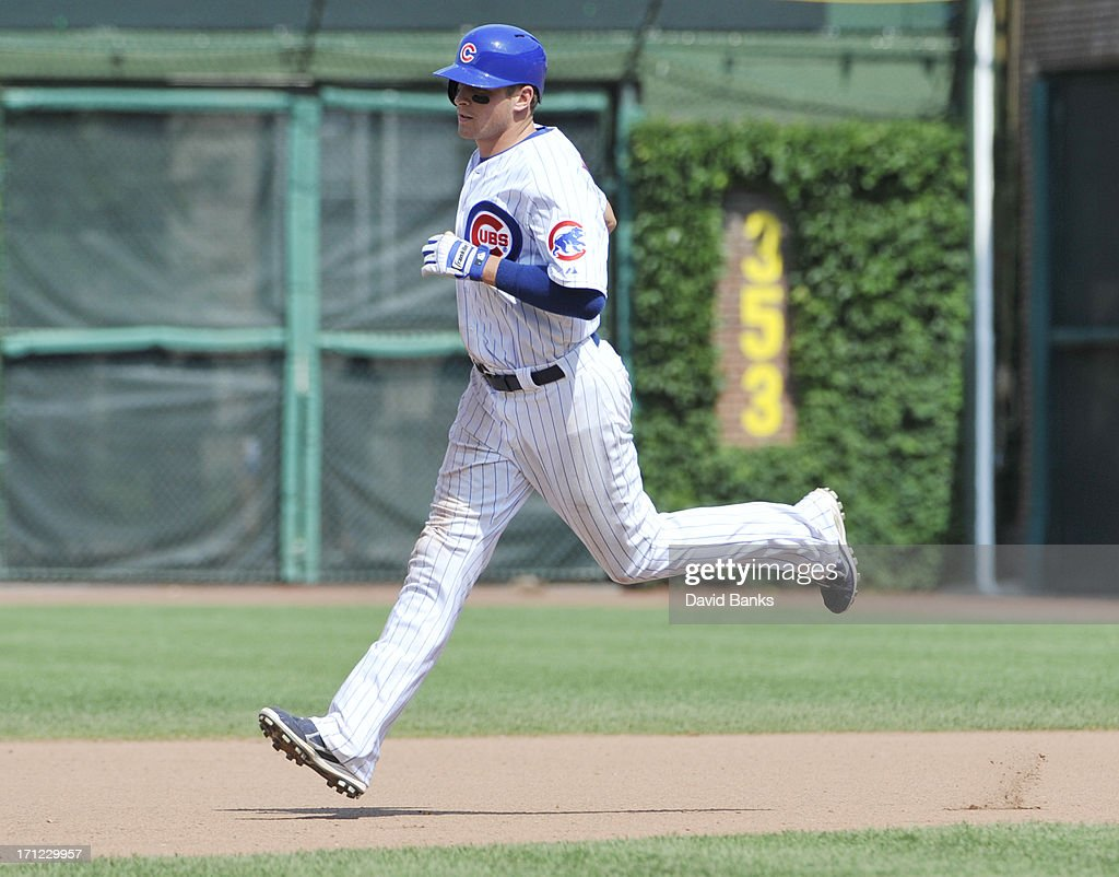 <a gi-track='captionPersonalityLinkClicked' href=/galleries/search?phrase=Ryan+Sweeney&family=editorial&specificpeople=711121 ng-click='$event.stopPropagation()'>Ryan Sweeney</a> #6 of the Chicago Cubs runs the bases after hitting a three-run homer against the Houston Astros during the seventh inning on June 23, 2013 at Wrigley Field in Chicago, Illinois.