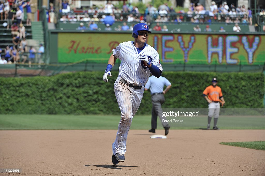 Ryan Sweeney #6 of the Chicago Cubs runs the bases after hitting a three-run homer against the Houston Astros during the seventh inning on June 23, 2013 at Wrigley Field in Chicago, Illinois.