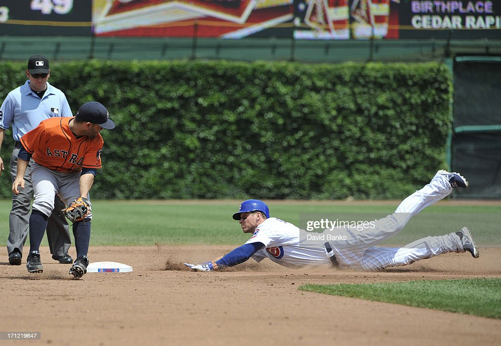 Ryan Sweeney #6 of the Chicago Cubs slides safely into second base with a two RBI double as Jose Altuve #27 of the Houston Astros takes the throw during the third inning on June 23, 2013 at Wrigley Field in Chicago, Illinois.