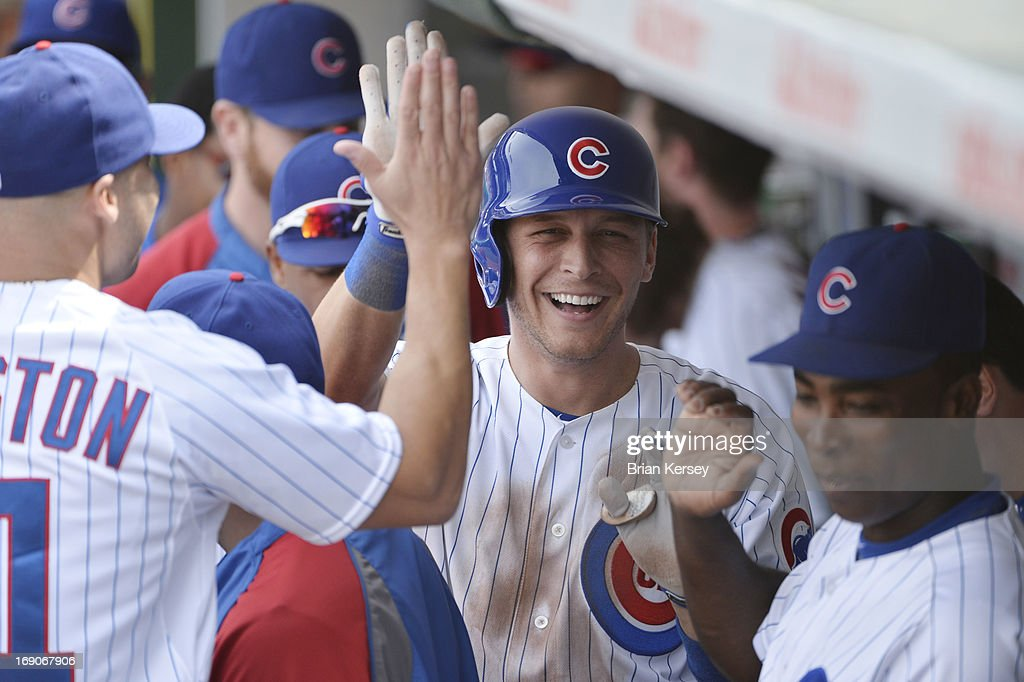 Ryan Sweeney #6 of the Chicago Cubs smiles after hitting a solo home run during the sixth inning against the New York Mets on May 19, 2013 at Wrigley Field in Chicago, Illinois.
