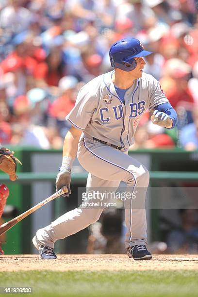 Ryan Sweeney of the Chicago Cubs takes a swing during a baseball game against the Washington Nationals on July 4 2014 at Nationals Park in Washington...