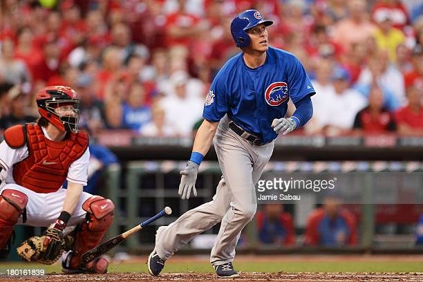 Ryan Sweeney of the Chicago Cubs watches his solo home run sail over the right field wall in the second inning against the Cincinnati Reds at Great...