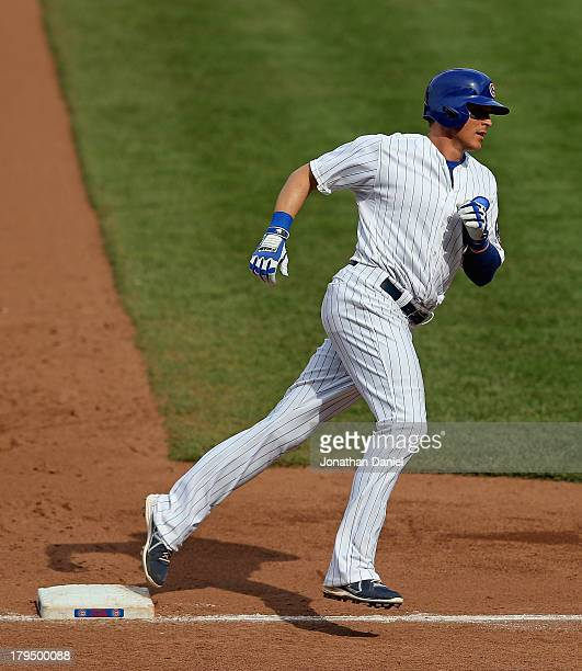 Ryan Sweeney of the Chicago Cubsruns the bases after hitting a solo home run in the 6th inning against the Miami Marlins at Wrigley Field on...