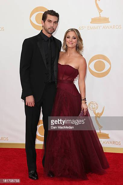 Ryan Sweeting and Kaley Cuoco arrive at the 65th Annual Primetime Emmy Awards at Nokia Theatre LA Live on September 22 2013 in Los Angeles California
