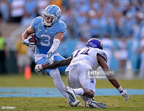 Ryan Switzer of the North Carolina Tar Heels eludes Taylor Reynolds of the James Madison Dukes during the game at Kenan Stadium on September 17 2016...