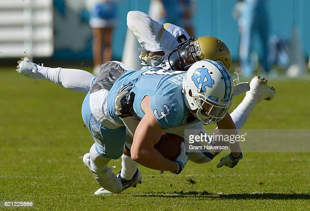 Ryan Switzer of the North Carolina Tar Heels makes a catch against Step Durham of the Georgia Tech Yellow Jackets during the game at Kenan Stadium on...