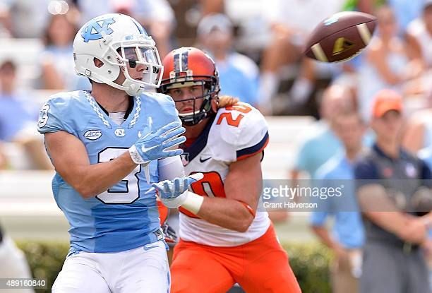 Ryan Switzer of the North Carolina Tar Heels makes a touchdown catch as Clayton Fejedelem of the Illinois Fighting Illini defends during their game...