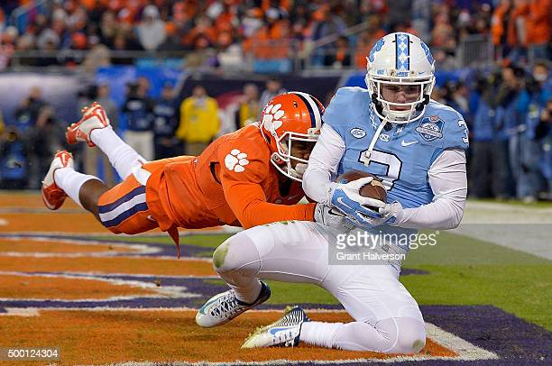 Ryan Switzer of the North Carolina Tar Heels makes a touchdown catch against Ryan Carter of the Clemson Tigers during the Atlantic Coast Conference...