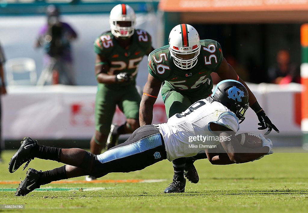 Ryan Switzer #3 of the North Carolina Tar Heels recovers a fumble during a game against the Miami Hurricanes at Sun Life Stadium on November 1, 2014 in Miami Gardens, Florida.