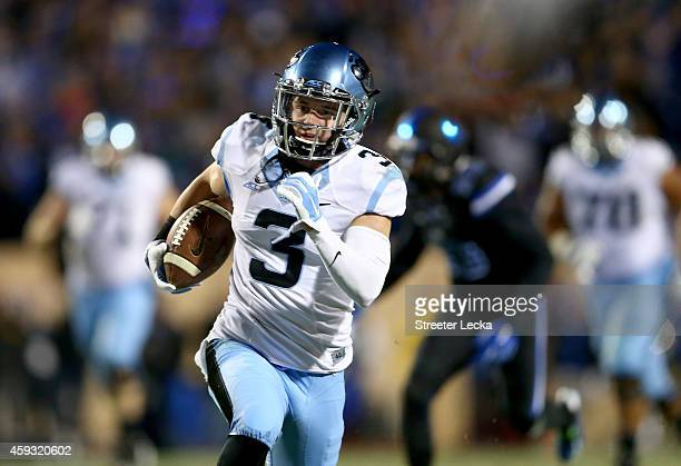 Ryan Switzer of the North Carolina Tar Heels runs with the ball against the Duke Blue Devils during their game at Wallace Wade Stadium on November 20...