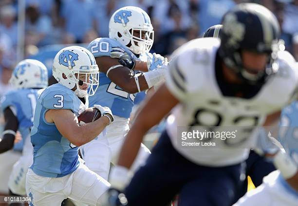 Ryan Switzer of the North Carolina Tar Heels runs with the ball against the Pittsburgh Panthers during their game at Kenan Stadium on September 24...