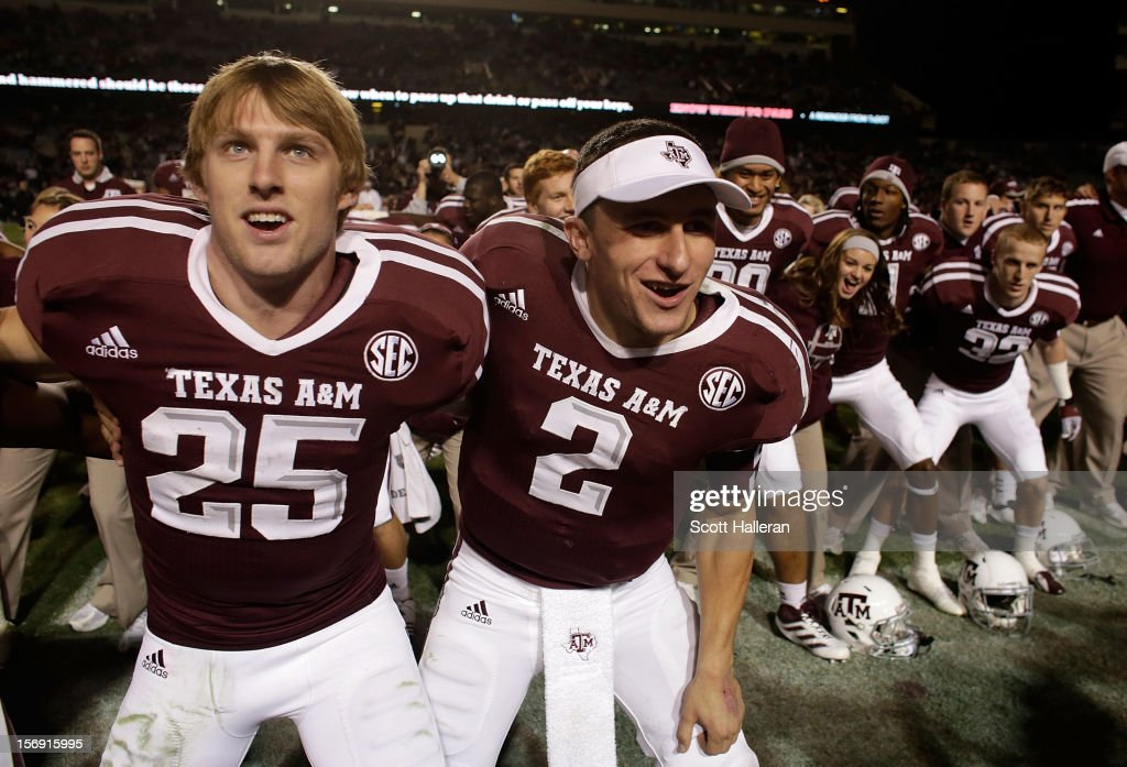 Ryan Swope #25 and <a gi-track='captionPersonalityLinkClicked' href=/galleries/search?phrase=Johnny+Manziel&family=editorial&specificpeople=9703372 ng-click='$event.stopPropagation()'>Johnny Manziel</a> #2 of the Texas A&M Aggies celebrate with teammates after defeating the Missouri Tigers 59-29 at Kyle Field on November 24, 2012 in College Station, Texas.