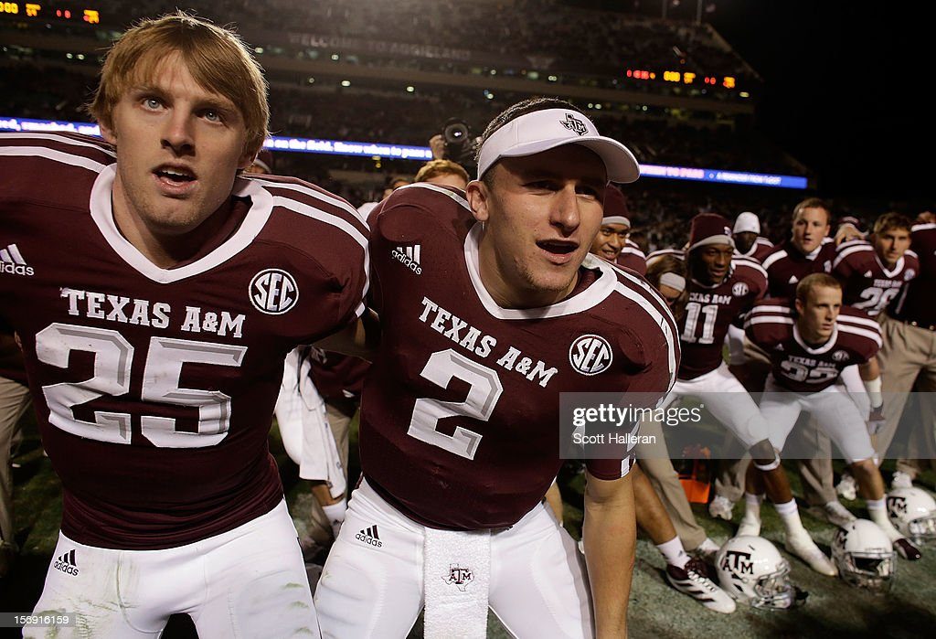 Ryan Swope #25 and Johnny Manziel #2 of the Texas A&M Aggies celebrate with teammates after defeating the Missouri Tigers 59-29 at Kyle Field on November 24, 2012 in College Station, Texas.