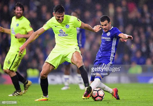 Ryan Tafazolli of Peterborough United and Pedro of Chelsea battle for possession during The Emirates FA Cup Third Round match between Chelsea and...