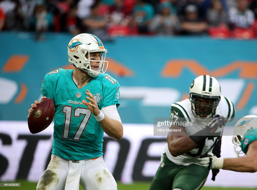 <a gi-track='captionPersonalityLinkClicked' href=/galleries/search?phrase=Ryan+Tannehill&family=editorial&specificpeople=5573174 ng-click='$event.stopPropagation()'>Ryan Tannehill</a> and <a gi-track='captionPersonalityLinkClicked' href=/galleries/search?phrase=Calvin+Pace&family=editorial&specificpeople=773024 ng-click='$event.stopPropagation()'>Calvin Pace</a> at the annual NFL International fixture as the New York Jets compete against the Miami Dolphins at Wembley Stadium on October 4, 2015 in London, England.