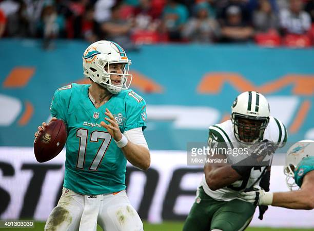 Ryan Tannehill and Calvin Pace at the annual NFL International fixture as the New York Jets compete against the Miami Dolphins at Wembley Stadium on...