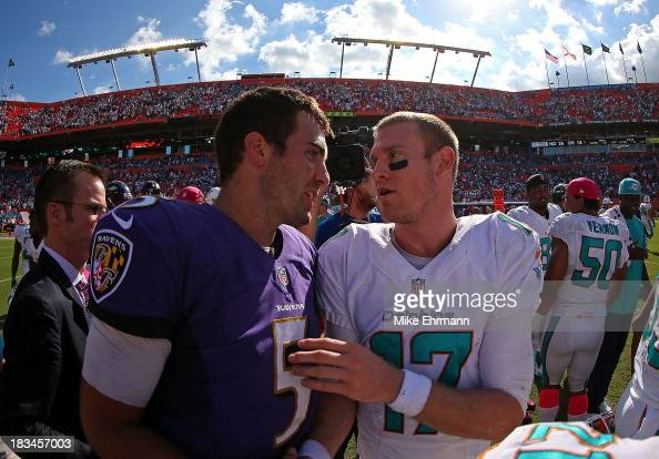 Ryan Tannehill of the Miami Dolphins and Joe Flacco of the Baltimore Ravens shake hands after a game at Sun Life Stadium on October 6 2013 in Miami...