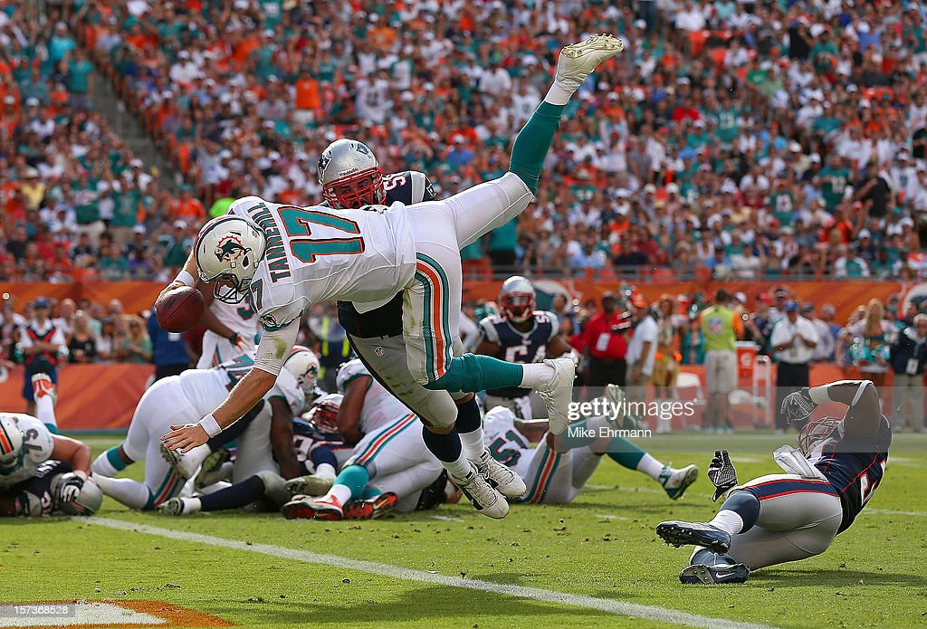 Ryan Tannehill #17 of the Miami Dolphins dives for a touchdown during a game against the New England Patriots at Sun Life Stadium on December 2, 2012 in Miami Gardens, Florida.