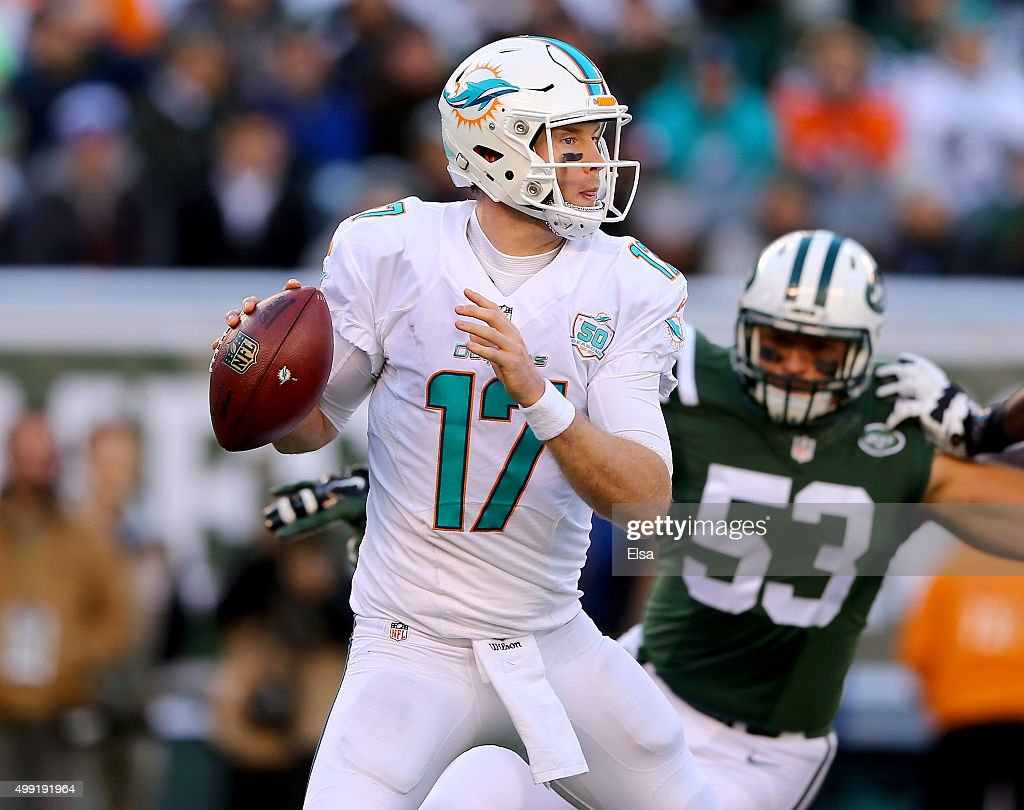 <a gi-track='captionPersonalityLinkClicked' href=/galleries/search?phrase=Ryan+Tannehill&family=editorial&specificpeople=5573174 ng-click='$event.stopPropagation()'>Ryan Tannehill</a> #17 of the Miami Dolphins drops back to pass as <a gi-track='captionPersonalityLinkClicked' href=/galleries/search?phrase=Mike+Catapano&family=editorial&specificpeople=10915328 ng-click='$event.stopPropagation()'>Mike Catapano</a> #53 of the New York Jets defends on November 29, 2015 at MetLife Stadium in East Rutherford, New Jersey.