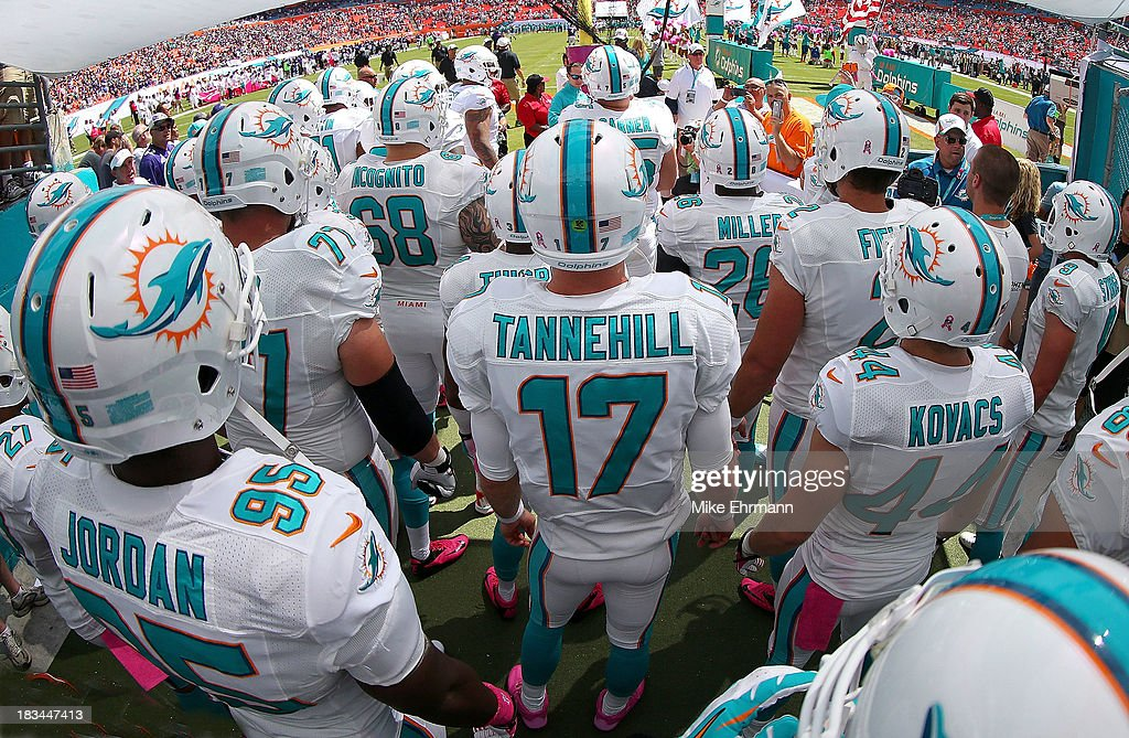 <a gi-track='captionPersonalityLinkClicked' href=/galleries/search?phrase=Ryan+Tannehill&family=editorial&specificpeople=5573174 ng-click='$event.stopPropagation()'>Ryan Tannehill</a> #17 of the Miami Dolphins gets ready to take the field during a game against the Baltimore Ravens at Sun Life Stadium on October 6, 2013 in Miami Gardens, Florida.