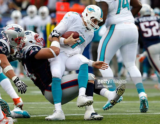 Ryan Tannehill of the Miami Dolphins is brought down by Chris Jones of the New England Patriots in the second half at Gillette Stadium on October 27...