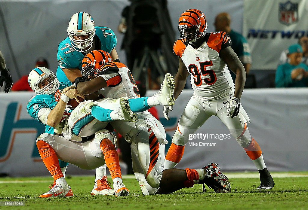 Ryan Tannehill #17 of the Miami Dolphins is sacked during a game against the Cincinnati Bengals at Sun Life Stadium on October 31, 2013 in Miami Gardens, Florida.